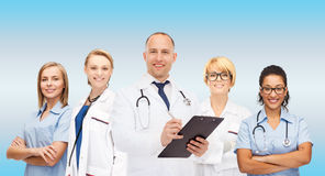 Group of smiling doctors with clipboard Stock Photography