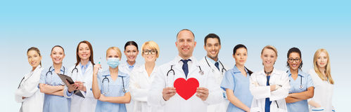 Group of smiling doctors with red heart shape Stock Photos