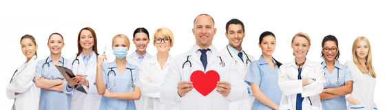 Group of smiling doctors with red heart shape Stock Photo