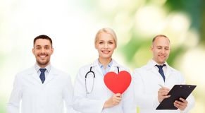 Group of smiling doctors with red heart shape Royalty Free Stock Photos