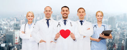 Group of smiling doctors with red heart shape Royalty Free Stock Photo
