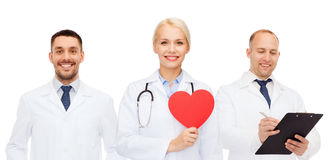 Group of smiling doctors with red heart shape Stock Image