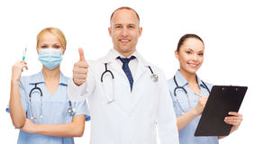 Group of smiling doctors with showing thumbs up Stock Photography