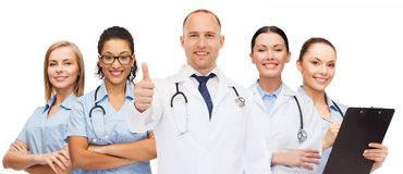 Group of smiling doctors with showing thumbs up Stock Photo