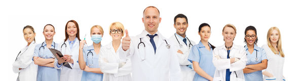Group of smiling doctors with showing thumbs up Royalty Free Stock Images