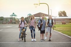 Group of smiling elementary school students on their way home. Photo of a diverse group of smiling elementary school students in the playground after school stock photos
