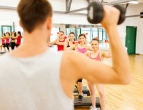 Group of smiling female with dumbbells and step Royalty Free Stock Photo