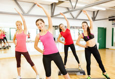 Group of smiling female stretching in gym Royalty Free Stock Photography