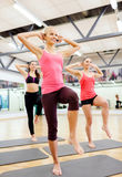 Group of smiling femalewith trainer exercising Royalty Free Stock Images