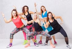 Group of smiling fitness girls having fun together royalty free stock photos