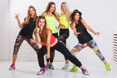 Group of smiling fitness girls having fun together royalty free stock photography