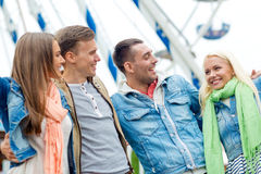 Group of smiling friends in amusement park Stock Photo