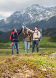 Group of smiling friends with backpacks hiking Stock Image
