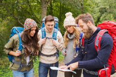 Group of smiling friends with backpacks hiking Stock Photo