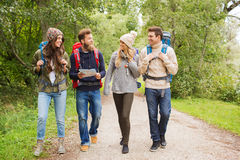 Group of smiling friends with backpacks hiking Stock Photos