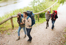 Group of smiling friends with backpacks hiking Stock Images