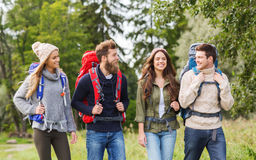 Group of smiling friends with backpacks hiking Royalty Free Stock Photos