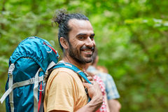 Group of smiling friends with backpacks hiking Royalty Free Stock Photography