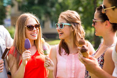 Group of smiling friends with ice cream outdoors stock photos