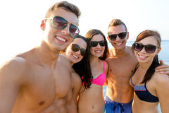 Group of smiling friends making selfie on beach royalty free stock photo