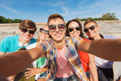 Group of smiling friends making selfie outdoors Royalty Free Stock Photos
