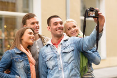 Group of smiling friends making selfie outdoors Royalty Free Stock Photography