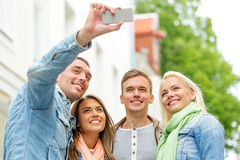 Group of smiling friends making selfie outdoors Stock Photography