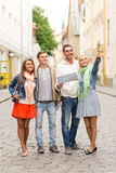 Group of smiling friends with map and photocamera Stock Photos