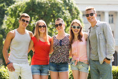 Group of smiling friends outdoors Stock Photo