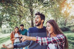Group of smiling friends outdoors in park Royalty Free Stock Photos