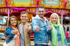 Group of smiling friends showing thumbs up Royalty Free Stock Photography