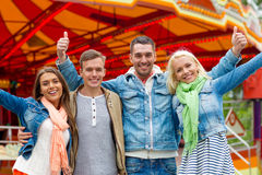Group of smiling friends showing thumbs up Stock Photo