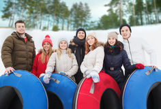 Group of smiling friends with snow tubes Royalty Free Stock Photos