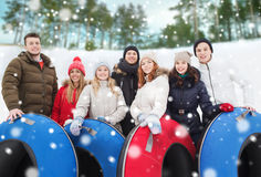 Group of smiling friends with snow tubes Stock Photos