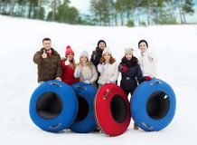 Group of smiling friends with snow tubes Royalty Free Stock Images