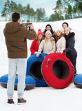 Group of smiling friends with snow tubes Royalty Free Stock Photography