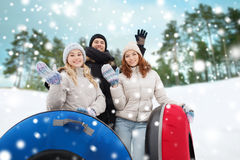 Group of smiling friends with snow tubes Stock Photo