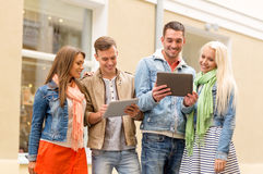 Group of smiling friends with tablet pc computers Stock Images