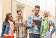 Group of smiling friends with tablet pc computers Royalty Free Stock Photography