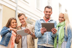 Group of smiling friends with tablet pc computers Royalty Free Stock Images
