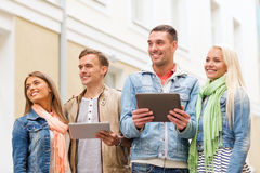 Group of smiling friends with tablet pc computers Stock Image