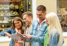 Group of smiling friends with tablet pc computers Stock Photography