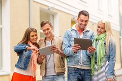 Group of smiling friends with tablet pc computers Royalty Free Stock Photo
