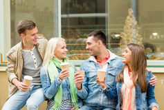 Group of smiling friends with take away coffee Stock Images