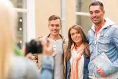 Group of smiling friends taking photo outdoors Stock Photo