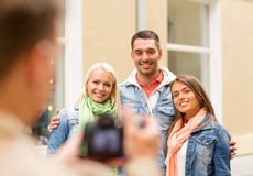 Group of smiling friends taking photo outdoors Stock Image