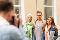 Group of smiling friends taking photo outdoors Royalty Free Stock Photos