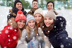Group of smiling friends taking selfie outdoors Stock Image