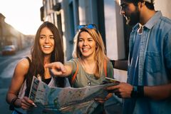 Group of smiling friends traveling. Friendship, travel, vacation, summer and people concept. Friendship, travel, vacation, summer and people concept. Group of stock image