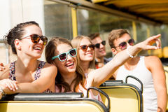Group of smiling friends traveling by tour bus Royalty Free Stock Photography